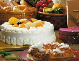 Cake with whipped cream and fruits