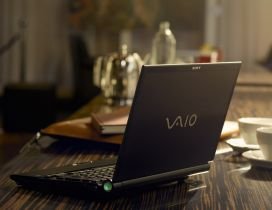 Laptop Sony Vayo on the table in the morning