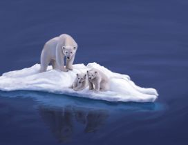 A polar bear and two cubs on the ice island