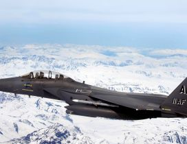 Aircraft Fighter AK 11AF flying over the white mountains
