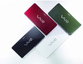 Four Sony Vaio laptops in different colors