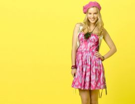 Bridgit Mendler in pink dress on the yellow background