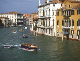 Buildings of Venice, Italy and speed boats on water