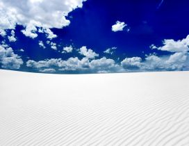White sand in desert and blue sky
