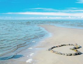 A heart from stones on the beach