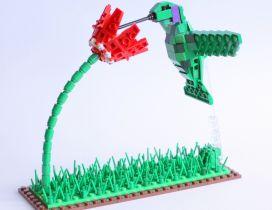 A green bird on the flower - Art made of lego