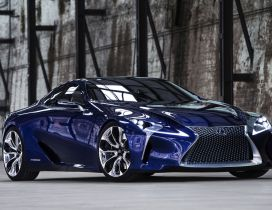 Blue Lexus LF-LC Coupe in a wilderness place