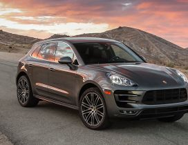 Porsche Macan on road between mountains