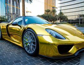 Gold Porsche 918 Spyder in the parking