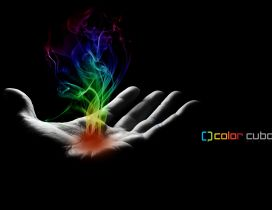 Smoke in many colors on a hand