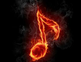 A musical note in flames on the black background