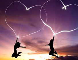 A couple fly hanged of two hearts - Love image