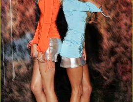 Victorias Secret models in blue and orange dress