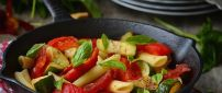 Pasta with vegetables and mint in pan