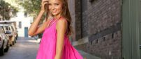 Miranda Kerr in a pink dress on the road