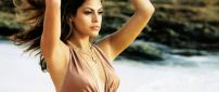 Eva Mendes with hair in the wind on the beach