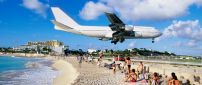 Airplane above the beach ready to land