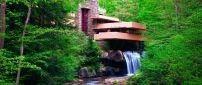 Building and waterfall in the green forest