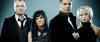 Members of skillet rock band in black