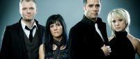 Members of skillet rock band in black
