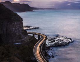 A long bridge besides the rocks