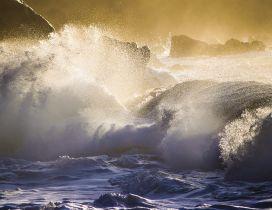 Large waves hit the rocks - Water wallpaper