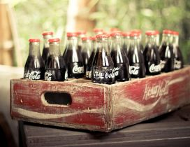 Old wooden box full with coca cola bottles