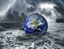 The Earth floats on the water in a stormy day