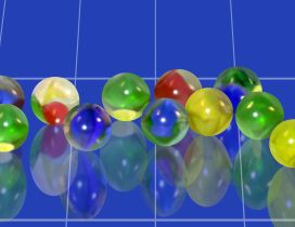 Many colored balls reflected in the blue mirror