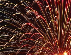 Bright red and golden fireworks in the night