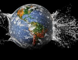 The Earth Globe in the water on the black background