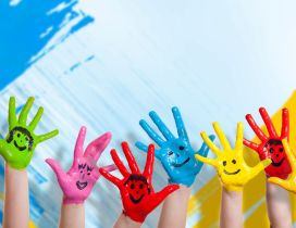 Happy colorful hands - Smiley face on the hands