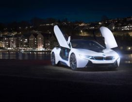 White BMW I8 Concept with opened doors in the city