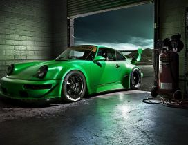 Green Porsche Carrera in a garage - Sports car
