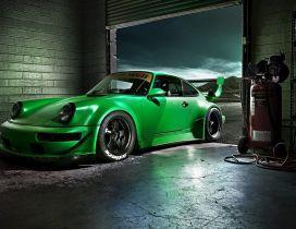 Green Porsche Carrera in a garage - Sports car