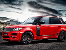 Red Startech Range Rover Pickup in the mountains
