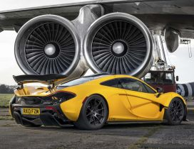 Yellow McLaren P1 on the airport - Sport car