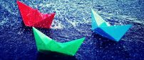 Three paper boats on the water - HD image