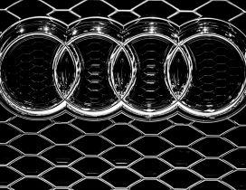 Audi emblem on a grille - Metal logo wallpaper