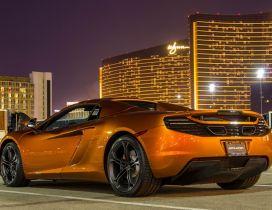 Superb gold McLaren 12C Spider back view