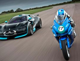 Blue and black Citroen and blue motorcycle race