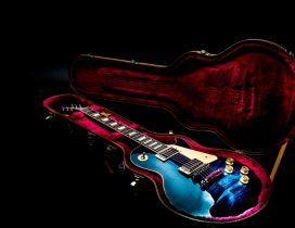 Colorful guitar in a red cover - Music wallpaper