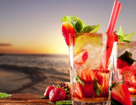 Cocktails made of strawberries and mint on beach