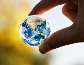 A small earth globe - The world in our hands