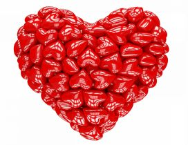 A big 3D heart made of many small red hearts