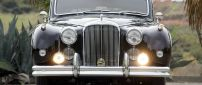 Black Classic Jaguar on road - Vintage car
