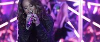 Rihanna sings in a concert - Singer wallpaper