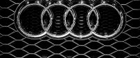 Audi emblem on a grille - Metal logo wallpaper