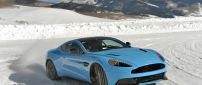 Blue Aston Martin Vanquish on snow