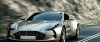 Gold Aston Martin Front View Wallpaper
